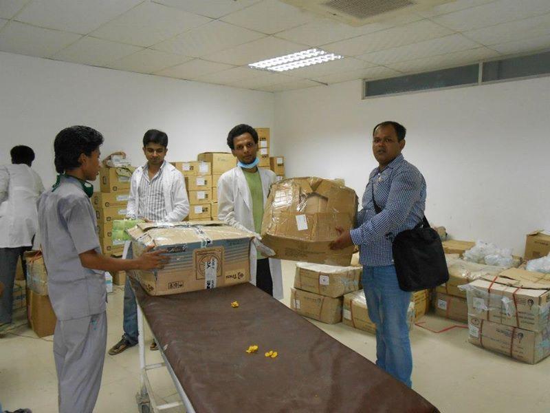 Handing over medicine at Enam Medical